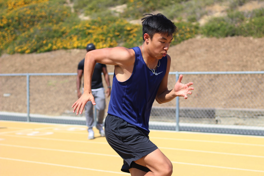 Junior Thomas Ear practices for distance events with his teammates.