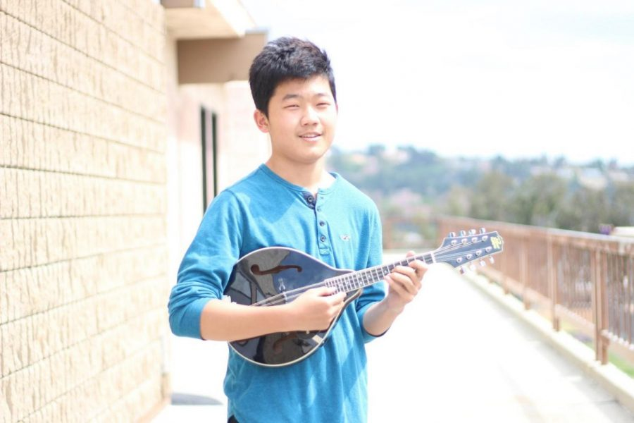 John Tai taught himself to play the mandolin and uses it to compose music.