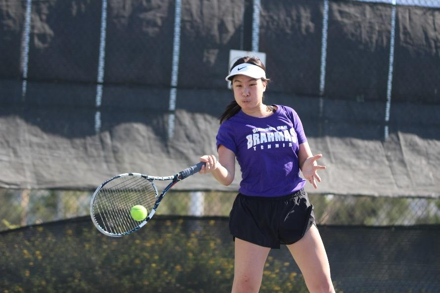 Junior+Kelly+Tsao+hits+a+forehand+in+her+doubles+win+to+help+the+Brahmas+win+their+match+16-2+against+South+Hills.%0A%0A