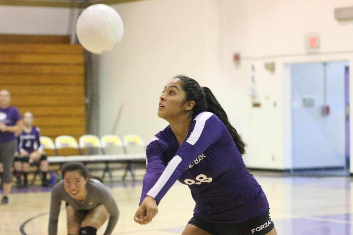 Joycelyn Ung, left, and Emily Licon coordinate a return against Walnut.