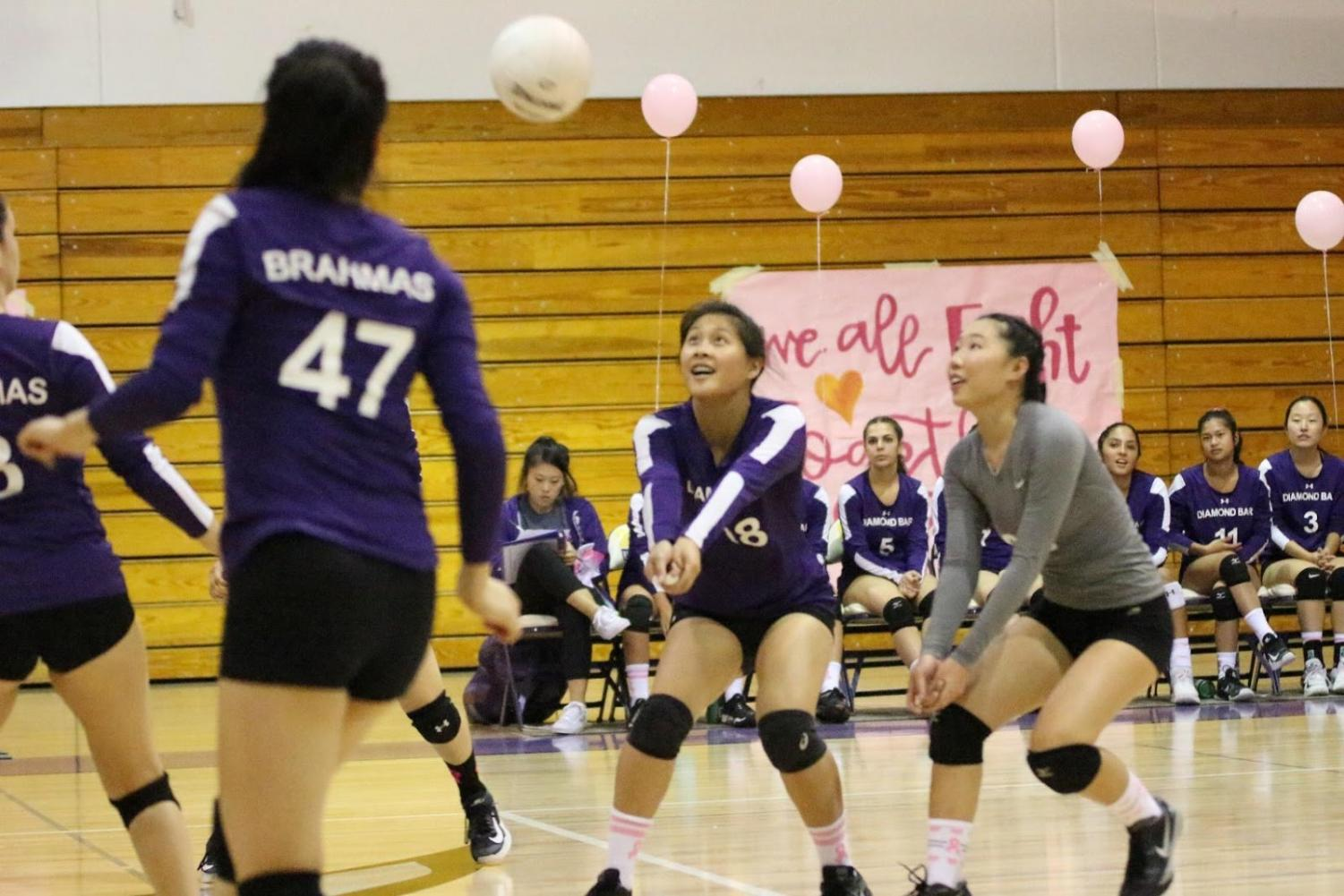 Angela+Zhang%2C+Lauren+Chang%2C+and+Joycelyn+Ung+return+the+ball+against+Chaffey+while+Kim+Flores+spikes+in+the+3-0+win.%0A%0A