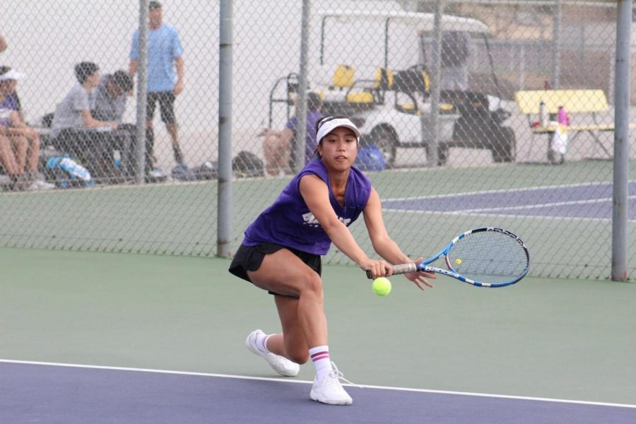 Senior singles player Ellie Delano steps into a backhand return in a 11-7 loss against Montclair, the team's only loss.