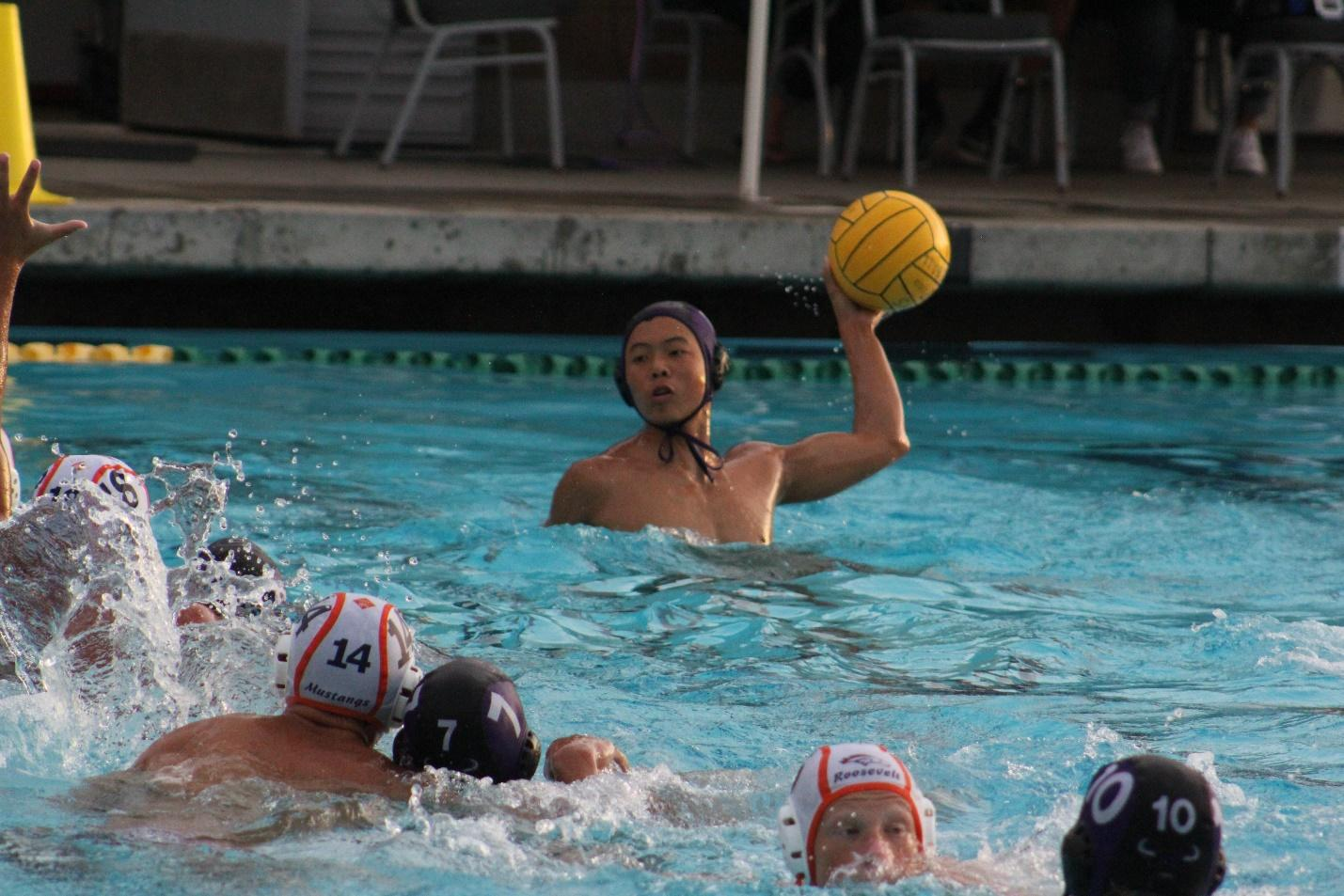 Senior Christian Cheung legs up against a Roosevelt defender in the 13-9 win.
