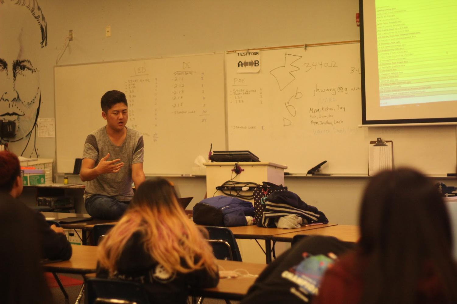 Robotics senior co-captain Kenneth Song assigns jobs during a club meeting to prepare for the First Robotics Competition Orange County Regional on Feb. 27.