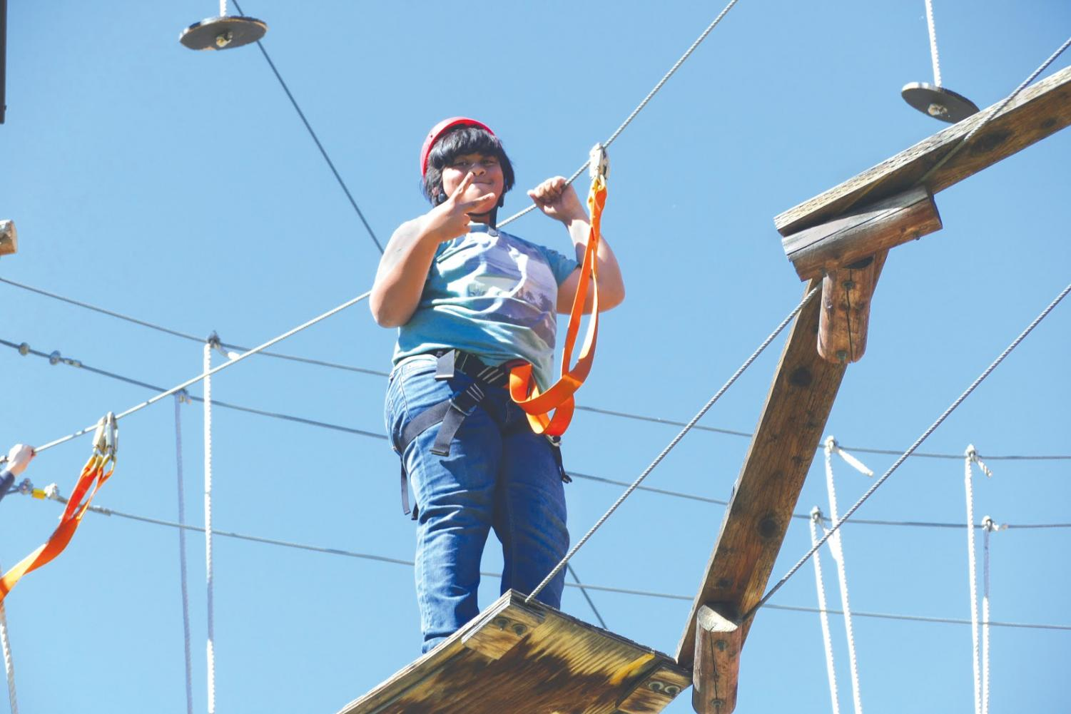 Junior Ryan Mendoza poses for the camera as he gets ready to zipline on Pathways's Orange County Ropes Course trip in Anaheim on Oct. 18.