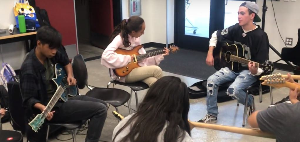 DBHS students visit Chaparral Middle School to help students in music.