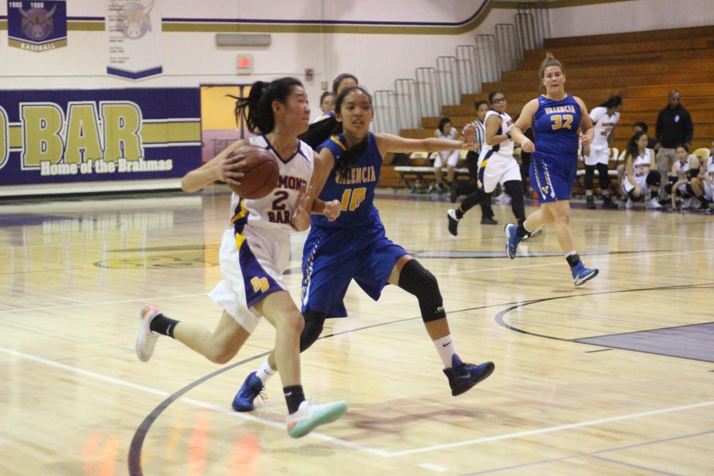 Junior Karen Shao drives to the basket during the first game of the season against Valencia. DB won the game, 56-25.