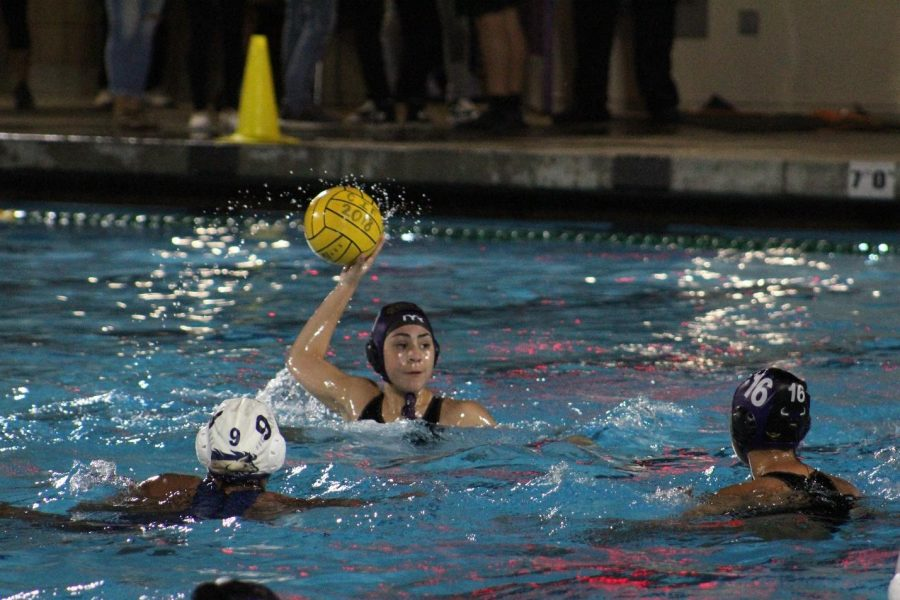 Senior Priscilla Franchino surveys the field for an open teammate in the rivalry season opener win against Walnut, 9-8.
