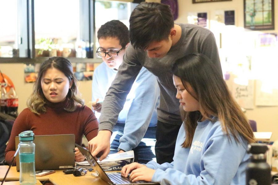 From left, seniors Yuwen Wang and Daniel Mansour, junior Ryan Lou and senior Heidi Luo prepare for L.A. regional finals.