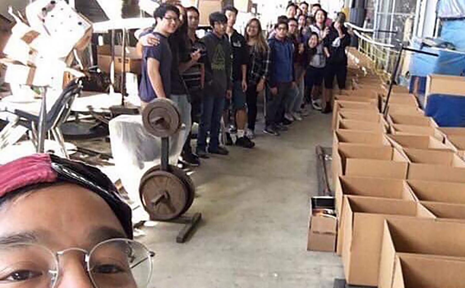 Photo courtesy of JUSTIN PANLILIO  Walnut High School Key Club advisor Justin Panlilio, along with WHS and DBHS Key Club members, prepare to pack cardboard boxes with donations.