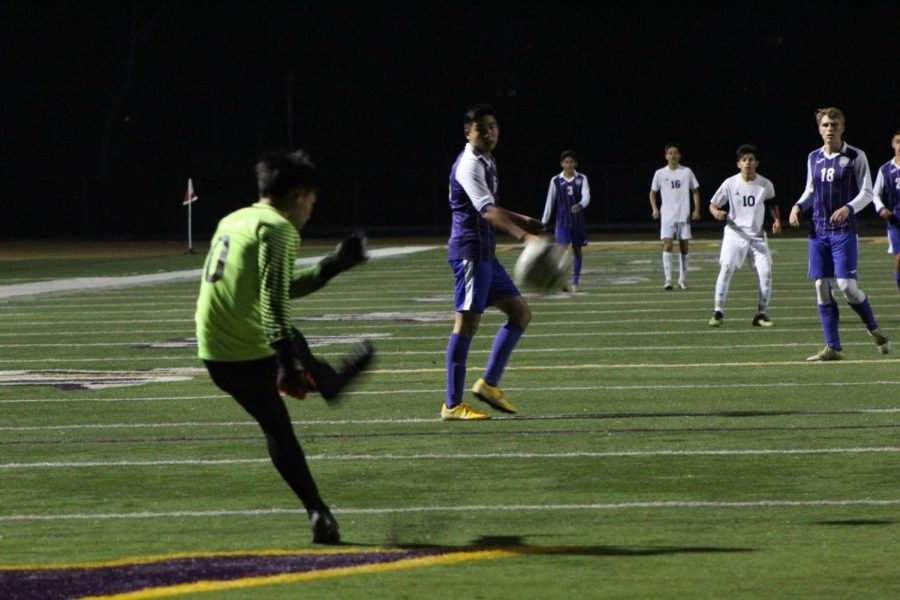 Junior goalie Ethan Lu clears the ball to his teammates in the match against Chaffey, which Diamond Bar won, 1-0.