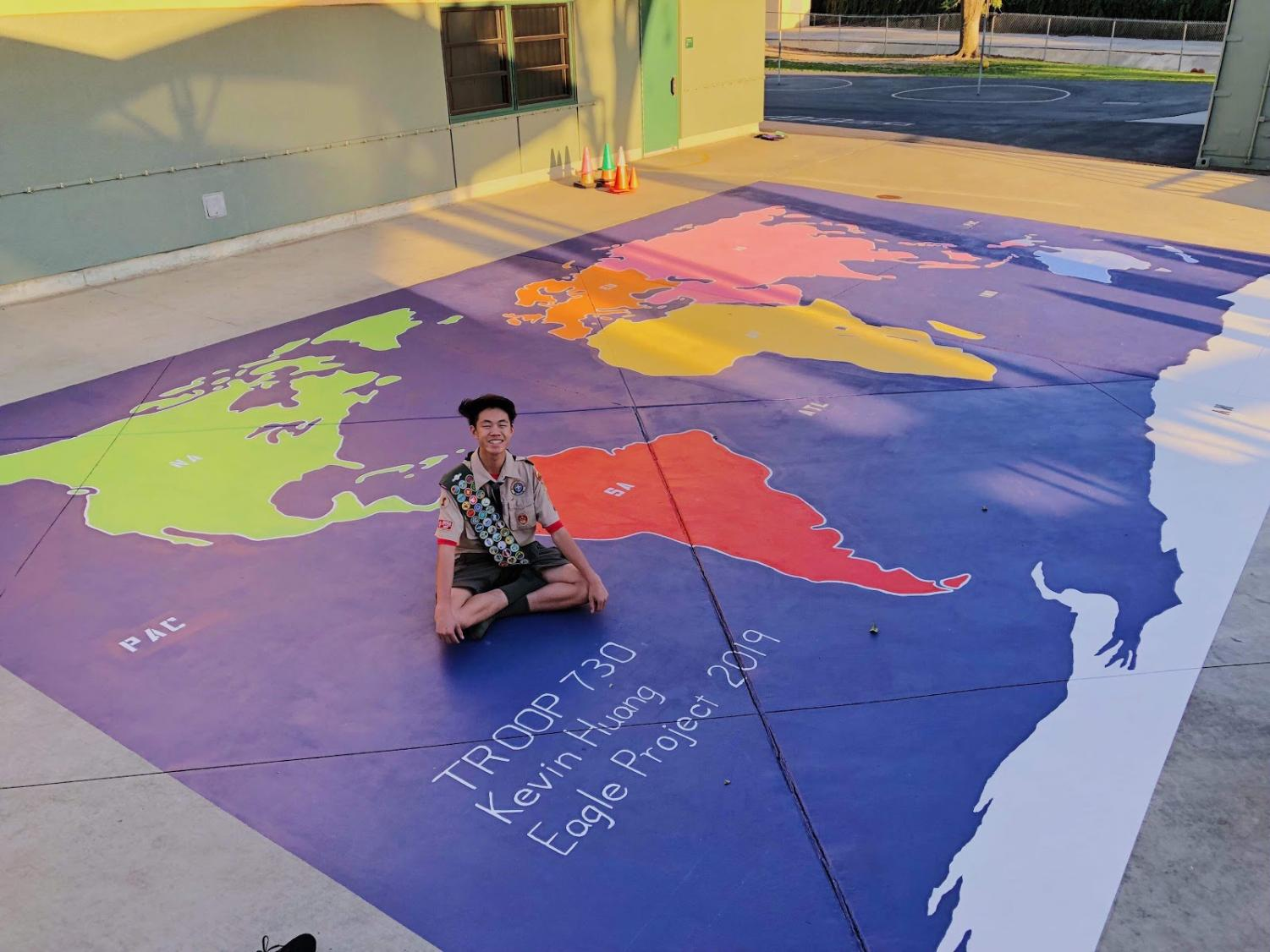 Junior Kevin Huang, along with 30 members from his troop, painted a world map in the lunch area at Evergreen Elementary School for his Eagle project.