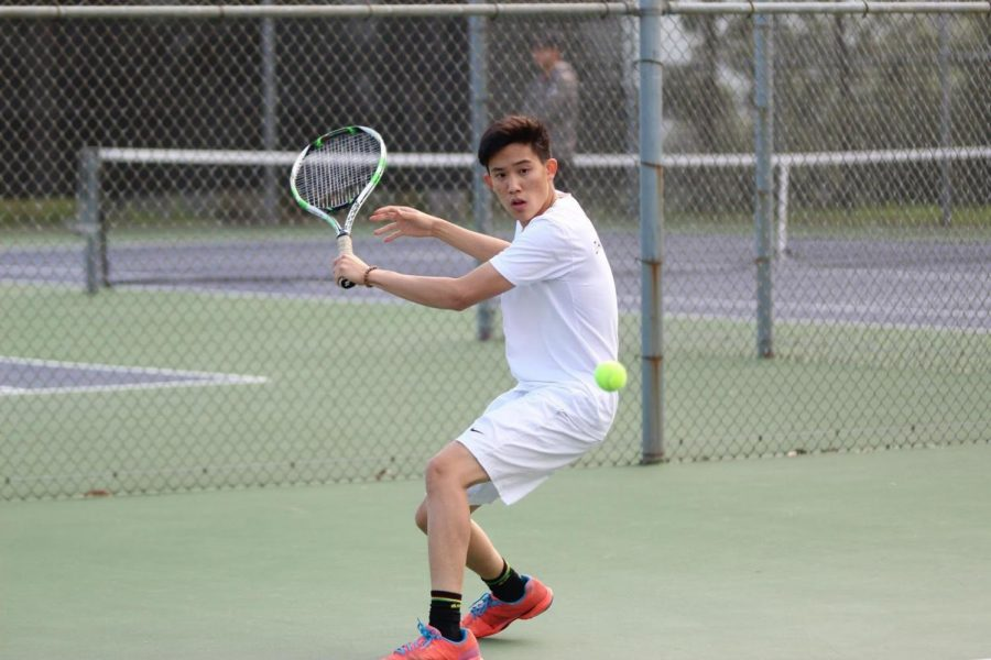 Senior Ethan Chen played singles for the team against Orange Lutheran, where the Brahmas lost in the close match,  11-7.
