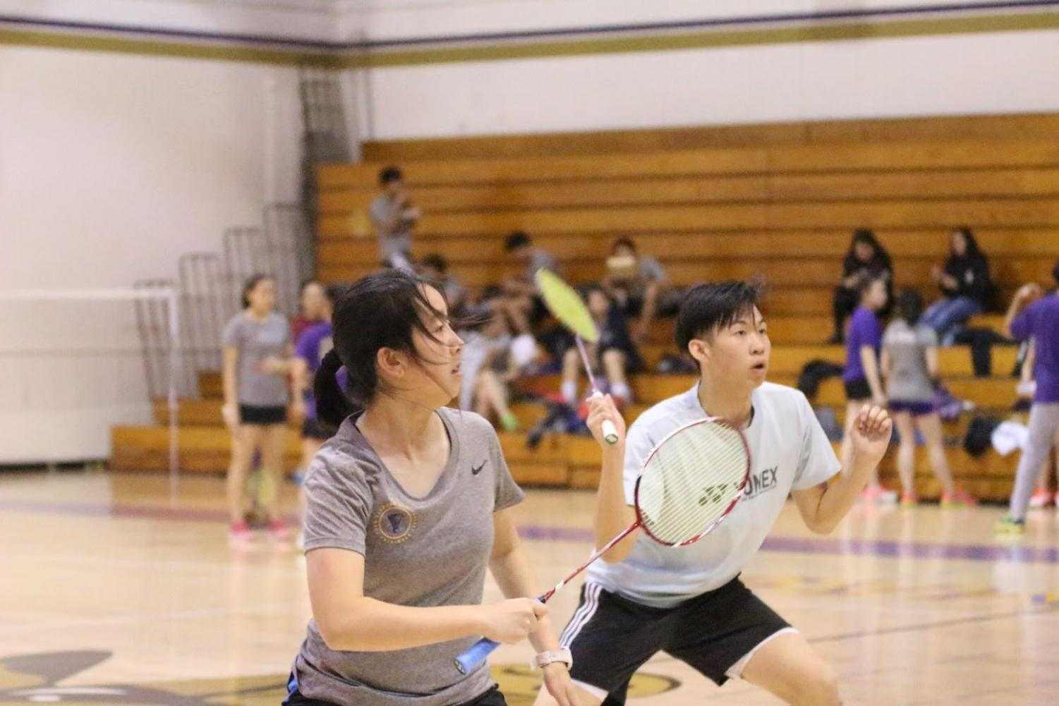 Sophomore Claire Wang, left, and senior Daniel Huang play in a doubles match during the Pasedena win.