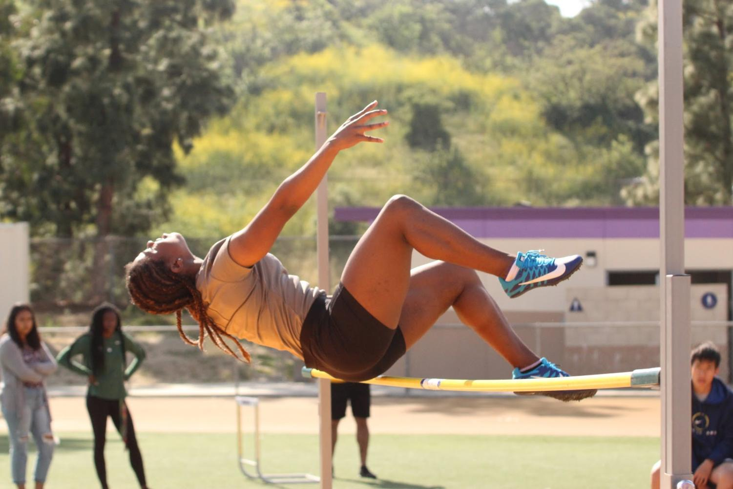 Senior Paula Williams competes in high jump during a meet against Ontario.