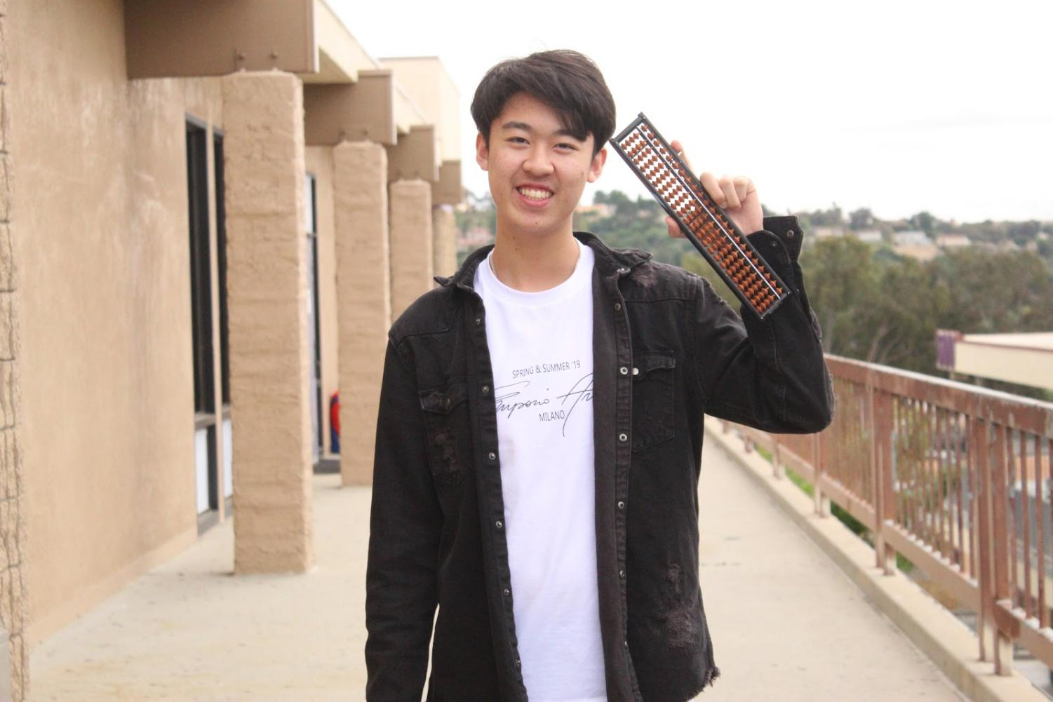 Junior Alec Chung volunteers with the United Abacus Arithmetic Association.