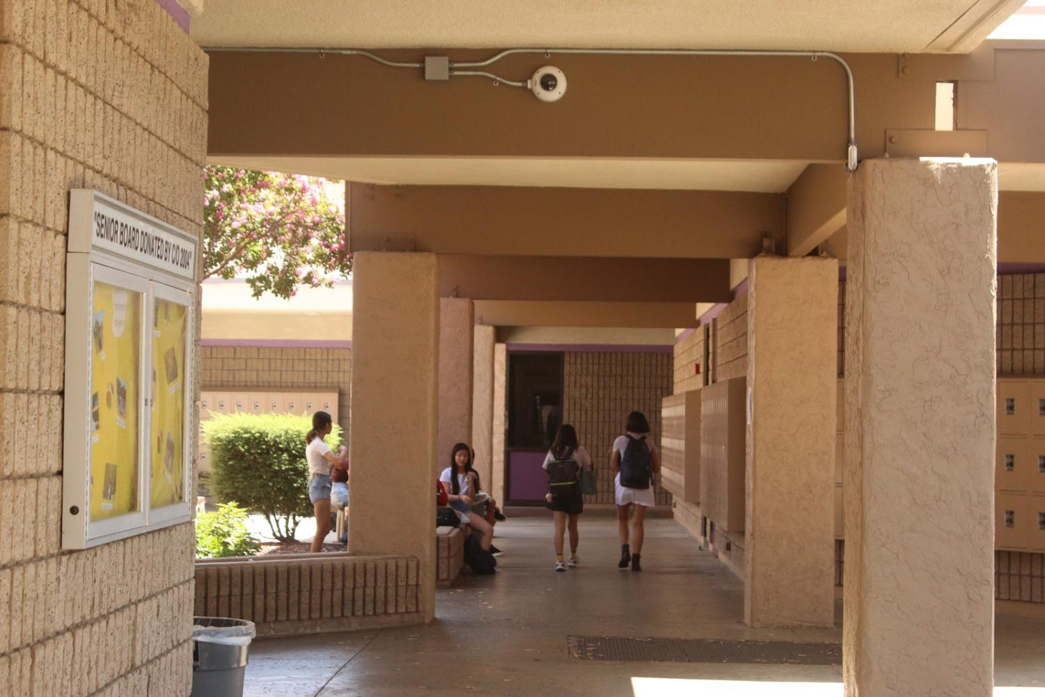 Security cameras can be seen in the hallways and on exterior walls on campus.