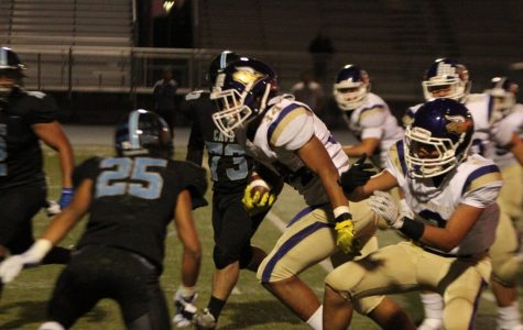 DB football evens record with league win