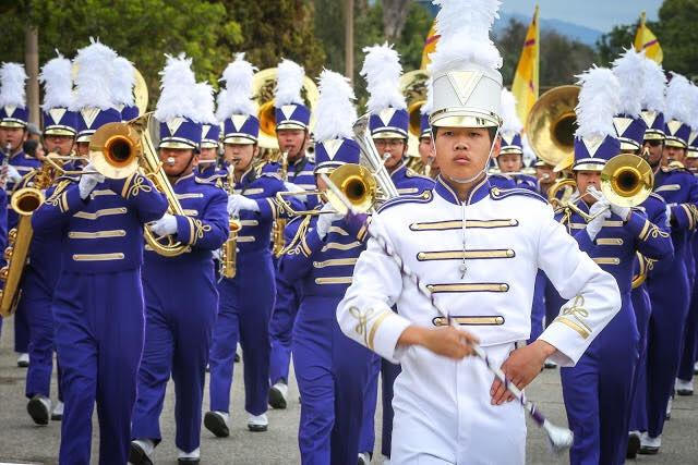 Senior drum major Jonathan Tan leads the Thundering Herd in performances.