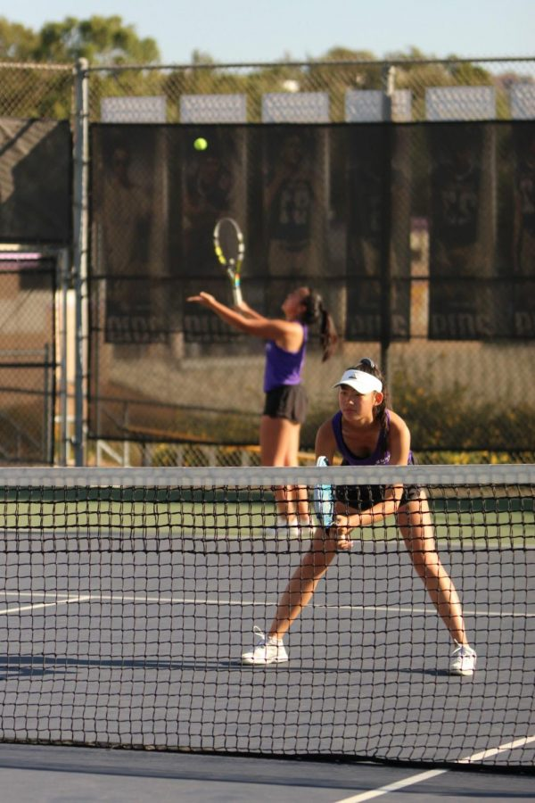 Senior Lauren Chen gets ready to rally the ball as her partner prepares to serve.