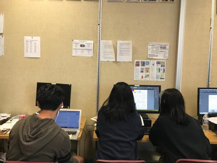 Members of The Bull's Eye staff work on layout pages and editing stories for their latest issue of the school newspaper.