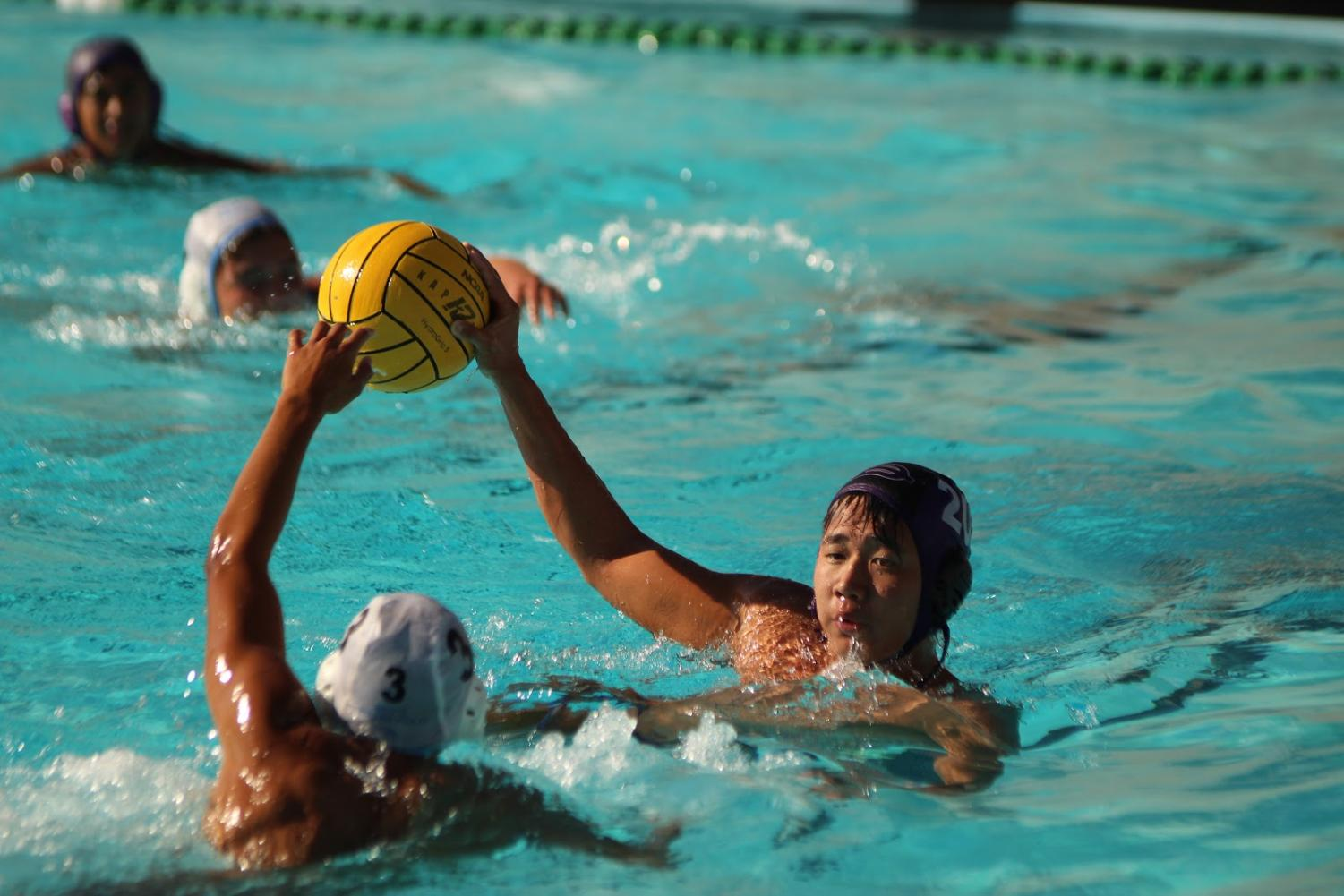 Senior Everett Chang goes for the shot when competing in the win against Ontario High School by a score of 19-7.