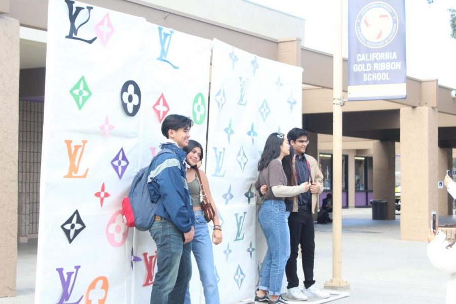 DBHS art commissioners created backdrops for students to pose with in celebration of the school's art department.