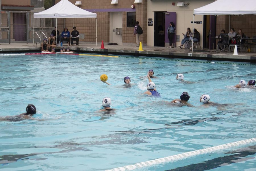 Senior Raquel Figueroa goes for the shot while teammates get ready to defend.