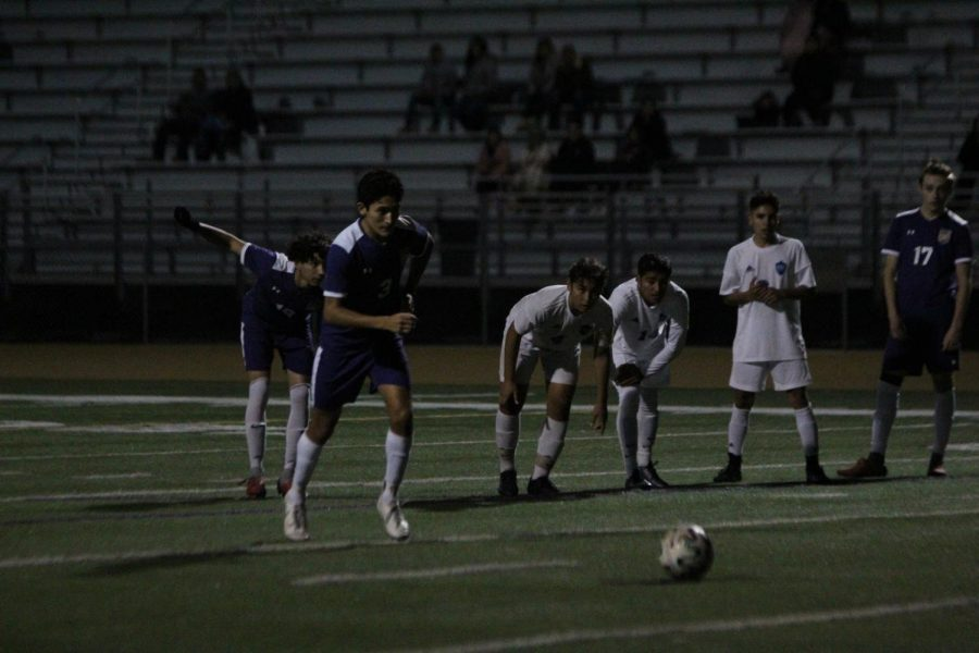 Junior+Jayden+Sanchez+goes+in+for+a+penalty+shot+against+Chino+High+School+while+teammates+anticipate+a+scored+goal.