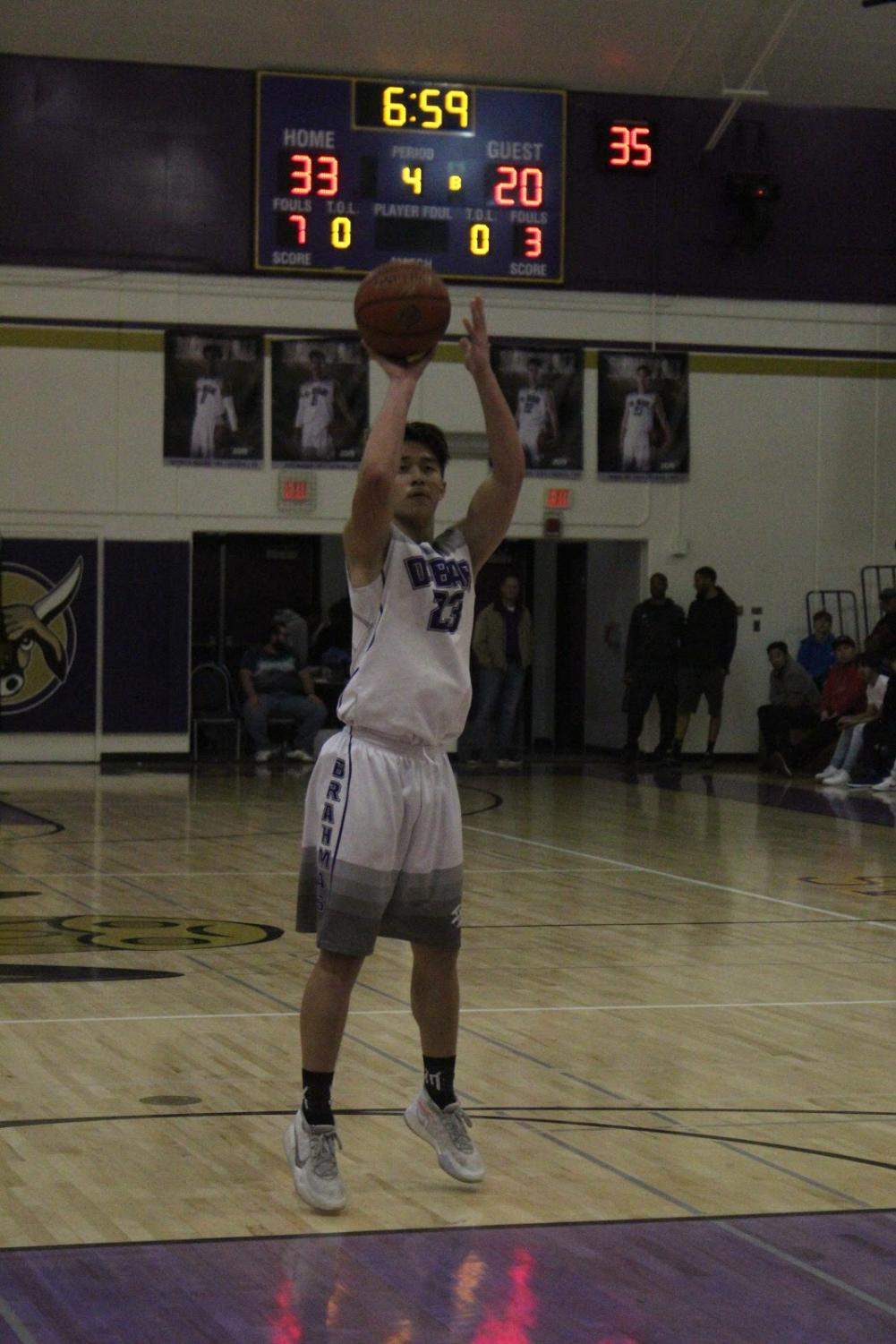 Senior Mark Wu attempts a free throw to contribute toward the Brahmas' dominant outing against Chino.