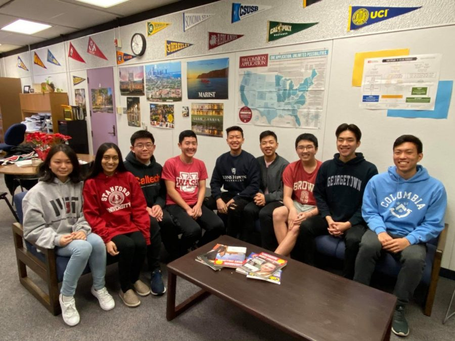 From left, seniors Catherine Lu, Mena Hassan, Jay Siri, Brandon Zhou, Lawrence Wang, Sean Chang, Mason Pan, Ryan Lou and Christopher Lee have received early admittance to well-known universities such as Stanford and Georgetown.