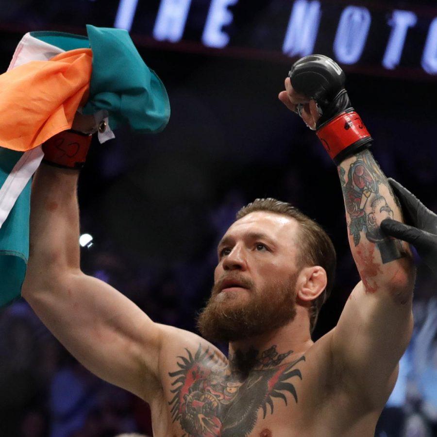 McGregor+slams+back+into+the+octagon