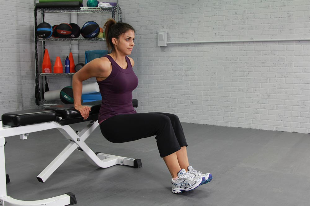 """Tricep dips are an isolation exercise that engages the triceps when the body """"dips"""" down."""