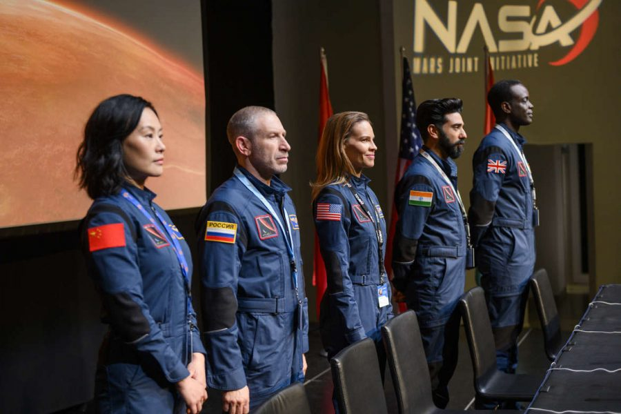 AWAY (L to R) VIVIAN WU as LU WANG, MARK IVANIR as MISHA POPOV, HILARY SWANK as EMMA GREEN, RAY PANTHAKI as RAM ARYA, and ATO ESSANDOH as DR. KWESI WEISBERG-ABBAN in episode 101 of AWAY. Cr. DIYAH PERA/NETFLIX © 2020