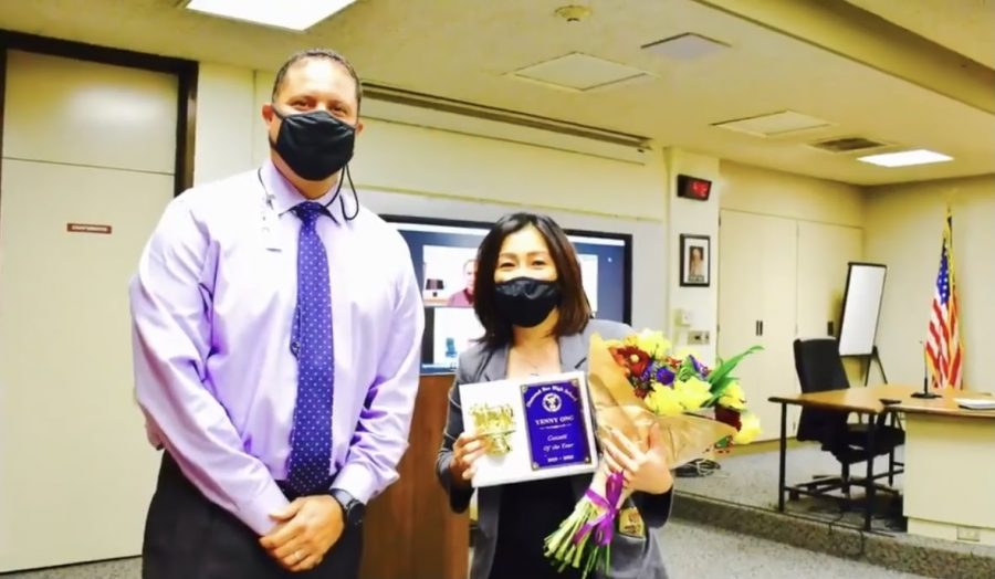 Nutrition Supervisor Yenny Ong, left receiving her award from principal Reuben Jones for all of her accomplishments for the school district.