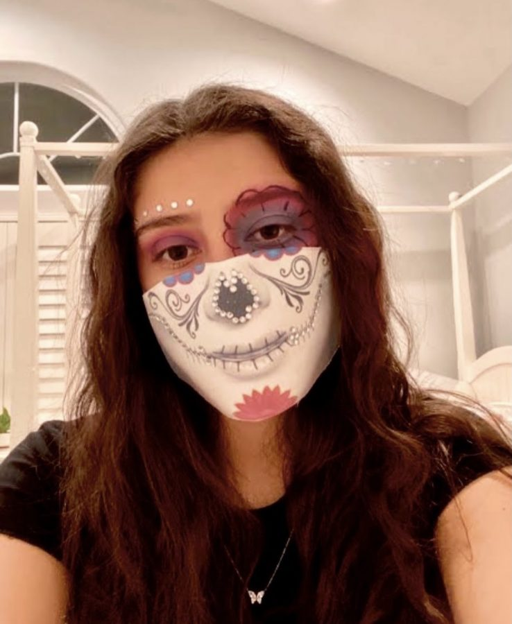 Club member Isabelle Hurtado won first place in the DIY mask competition the club hosted.